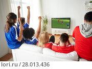 Купить «football fans watching soccer game on tv at home», фото № 28013436, снято 14 августа 2016 г. (c) Syda Productions / Фотобанк Лори