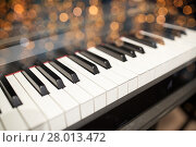 Купить «close up of grand piano keyboard», фото № 28013472, снято 18 августа 2016 г. (c) Syda Productions / Фотобанк Лори