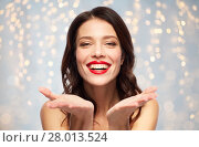 Купить «beautiful smiling young woman with red lipstick», фото № 28013524, снято 5 января 2018 г. (c) Syda Productions / Фотобанк Лори