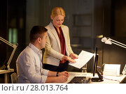 Купить «business team with papers working late at office», фото № 28013764, снято 6 декабря 2017 г. (c) Syda Productions / Фотобанк Лори