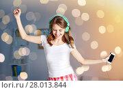 Купить «happy woman in headphones ihaving fun at home», фото № 28013844, снято 14 ноября 2015 г. (c) Syda Productions / Фотобанк Лори