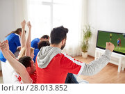 Купить «football fans watching soccer game on tv at home», фото № 28013852, снято 14 августа 2016 г. (c) Syda Productions / Фотобанк Лори