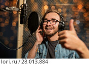 Купить «man with headphones at music recording studio», фото № 28013884, снято 18 августа 2016 г. (c) Syda Productions / Фотобанк Лори