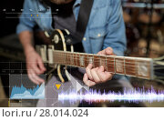 Купить «close up of man playing guitar at studio rehearsal», фото № 28014024, снято 18 августа 2016 г. (c) Syda Productions / Фотобанк Лори