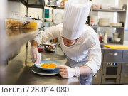 Купить «happy male chef cooking food at restaurant kitchen», фото № 28014080, снято 2 апреля 2017 г. (c) Syda Productions / Фотобанк Лори