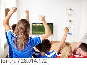Купить «friends or soccer fans watching game on tv at home», фото № 28014172, снято 14 августа 2016 г. (c) Syda Productions / Фотобанк Лори