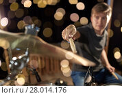 Купить «male musician playing drum kit at concert», фото № 28014176, снято 18 августа 2016 г. (c) Syda Productions / Фотобанк Лори