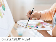 Купить «artist with palette painting at art studio», фото № 28014324, снято 1 июня 2017 г. (c) Syda Productions / Фотобанк Лори