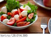 Купить «close up of vegetable salad with mozzarella», фото № 28014380, снято 5 октября 2017 г. (c) Syda Productions / Фотобанк Лори