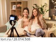 Купить «female bloggers with camera recording home video», фото № 28014508, снято 21 января 2018 г. (c) Syda Productions / Фотобанк Лори