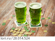 Купить «glasses of green beer and gold coins on table», фото № 28014524, снято 31 января 2018 г. (c) Syda Productions / Фотобанк Лори