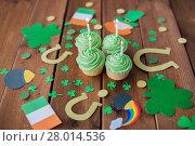 Купить «green cupcakes and st patricks day decorations», фото № 28014536, снято 31 января 2018 г. (c) Syda Productions / Фотобанк Лори