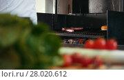 Купить «chef prepares grilled meat greasing it with oil, fresh vegetables in the foreground», видеоролик № 28020612, снято 27 мая 2020 г. (c) Константин Шишкин / Фотобанк Лори