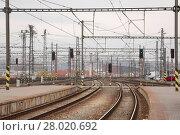 Купить «Railroad tracks with train», фото № 28020692, снято 20 февраля 2019 г. (c) PantherMedia / Фотобанк Лори