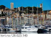Купить «Yachts moored in port of Cannes», фото № 28023140, снято 3 декабря 2017 г. (c) Яков Филимонов / Фотобанк Лори