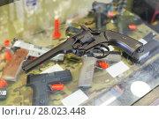 Купить «pistol on the glass table in army shop», фото № 28023448, снято 4 июля 2017 г. (c) Яков Филимонов / Фотобанк Лори