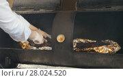 Купить «Chef smoking the meat on the grill in commercial kitchen», видеоролик № 28024520, снято 23 июля 2019 г. (c) Константин Шишкин / Фотобанк Лори