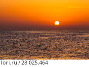Купить «beautiful sunset above the sea.  Colorful sunset over water surface», фото № 28025464, снято 18 июня 2019 г. (c) PantherMedia / Фотобанк Лори