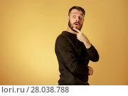 Купить «Portrait of young man with shocked facial expression», фото № 28038788, снято 24 марта 2019 г. (c) PantherMedia / Фотобанк Лори