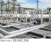 Купить «Heat exchangers in refineries. The equipment for oil refining. Heat exchanger for flammable liquids. The plant for the primary processing of oil», фото № 28042356, снято 20 апреля 2018 г. (c) PantherMedia / Фотобанк Лори