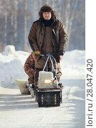 Купить «Compact snowmobile for hunting - motorcycle towing pulls cargo on snow countryside», фото № 28047420, снято 17 февраля 2018 г. (c) Константин Шишкин / Фотобанк Лори