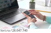 Купить «designer working on smartphone interface design», видеоролик № 28047740, снято 10 февраля 2018 г. (c) Syda Productions / Фотобанк Лори