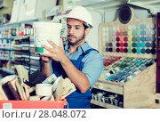 foreman closely reading instruction on paint. Стоковое фото, фотограф Яков Филимонов / Фотобанк Лори