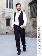 Купить «Man in formalwear walking along street», фото № 28048140, снято 5 августа 2017 г. (c) Яков Филимонов / Фотобанк Лори