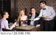 Купить «waiter bringing ordered dishes to guests», фото № 28048196, снято 8 января 2018 г. (c) Яков Филимонов / Фотобанк Лори