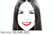 Купить «Cheerful brunette woman winks at camera close-up», видеоролик № 28049392, снято 22 февраля 2015 г. (c) Алексей Кузнецов / Фотобанк Лори