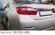 Купить «Auto service - back headlights of car», фото № 28052456, снято 23 мая 2018 г. (c) Константин Шишкин / Фотобанк Лори
