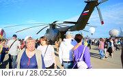 Купить «Zhukovsky, Russia - July 24. 2017. Russian heavy multipurpose transport helicopter Mi 26 at international aerospace show MAKS 2017», видеоролик № 28052560, снято 22 июля 2017 г. (c) Володина Ольга / Фотобанк Лори