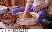 Купить «Potter putting clay on the potter's wheel and began shaping a clay pot», видеоролик № 28052580, снято 24 марта 2016 г. (c) Алексей Кузнецов / Фотобанк Лори