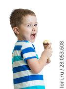 Купить «Child eating ice cream isolated on white», фото № 28053608, снято 11 июля 2020 г. (c) Оксана Кузьмина / Фотобанк Лори