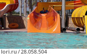 Купить «Little girl sliding down on water slide in water park», видеоролик № 28058504, снято 6 июня 2014 г. (c) Алексей Кузнецов / Фотобанк Лори