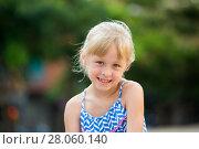 Купить «Portrait of happy girl outdoors», фото № 28060140, снято 20 июля 2017 г. (c) Яков Филимонов / Фотобанк Лори