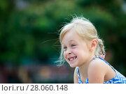 Купить «Portrait of happy girl outdoors», фото № 28060148, снято 20 июля 2017 г. (c) Яков Филимонов / Фотобанк Лори
