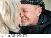 Купить «Счастливая семья. Влюблённые мужчина и женщина среднего возраста стоят и смотрят друг на друга зимой на улице. Фокус на мужчине», эксклюзивное фото № 28060376, снято 23 января 2018 г. (c) Игорь Низов / Фотобанк Лори