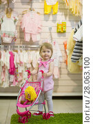Купить «Little blonde girl smiling and clapping her hands in the kids' store with the toy baby carriage», фото № 28063100, снято 11 мая 2017 г. (c) Константин Шишкин / Фотобанк Лори