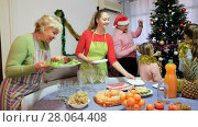 Купить «Family is preparing for celebration New Year together at home», видеоролик № 28064408, снято 17 января 2018 г. (c) Яков Филимонов / Фотобанк Лори