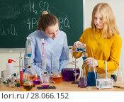 Купить «two girls doing chemical experiments», фото № 28066152, снято 17 февраля 2018 г. (c) Майя Крученкова / Фотобанк Лори
