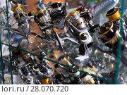 Купить «Close-up photo of variety baitcasting reel», фото № 28070720, снято 16 января 2018 г. (c) Яков Филимонов / Фотобанк Лори