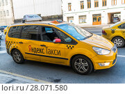 Купить «Moscow, Russia - July 24. 2017. Taxi company Yandex go on prospekt Mira street», фото № 28071580, снято 24 июля 2017 г. (c) Володина Ольга / Фотобанк Лори