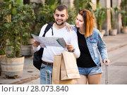 Купить «Portrait of young tourists with map and baggage», фото № 28073840, снято 25 мая 2017 г. (c) Яков Филимонов / Фотобанк Лори