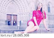 Купить «portrait of young adult girl in evening apparel sitting in european town», фото № 28085308, снято 24 июня 2017 г. (c) Яков Филимонов / Фотобанк Лори