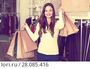 Купить «Young woman with bags happinnes from purchases in the clothes shop», фото № 28085416, снято 17 января 2018 г. (c) Яков Филимонов / Фотобанк Лори