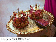 Купить «Gold crowns for wedding and Bible», фото № 28085680, снято 12 августа 2011 г. (c) Юрий Бизгаймер / Фотобанк Лори