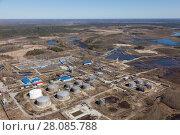 Купить «Top view of oil storage tanks», фото № 28085788, снято 2 июня 2017 г. (c) Владимир Мельников / Фотобанк Лори