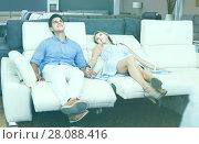 Купить «Family choosing new sofa with a rising bottom», фото № 28088416, снято 19 июня 2017 г. (c) Яков Филимонов / Фотобанк Лори