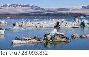 Купить «Fantastic view of floating icebergs in the glacial lake Jokulsarlon on the background of clear blue sky, Iceland», видеоролик № 28093852, снято 12 ноября 2017 г. (c) Алексей Кузнецов / Фотобанк Лори